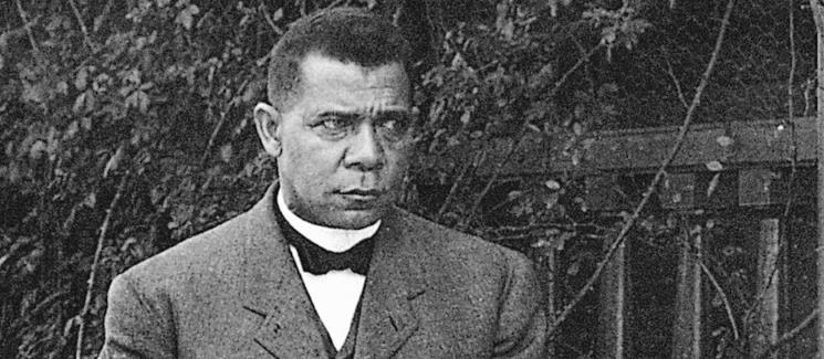 Booker T. Washington in front of foliage