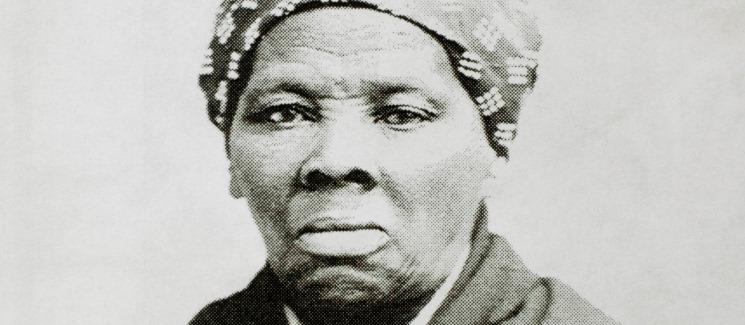 Harriet Tubman on a gray background