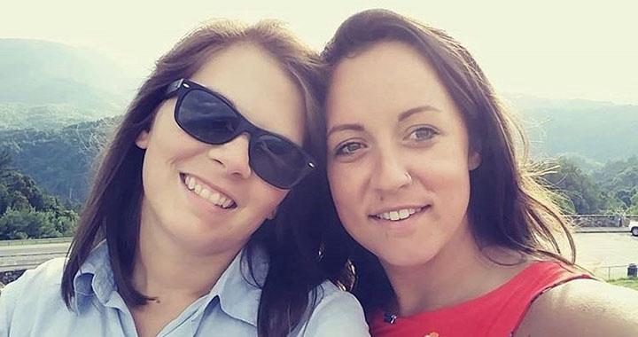 two women smile