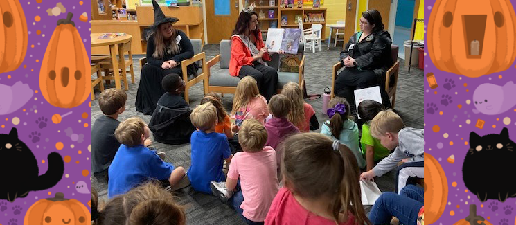 Photo of Sigma Tau Delta Members Harley Mercadal, Taylor Hubbard, and Brooke Johnson reading to Towne Acres students.