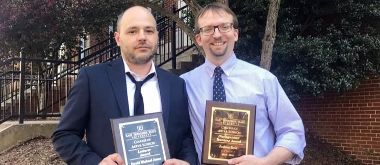 Image of Dr. Michael Jones and Dr. Josh Reid, holding plaques indicating their awards