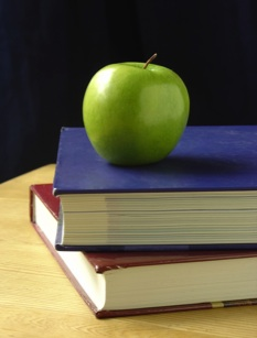 Apple on top of a stack of books