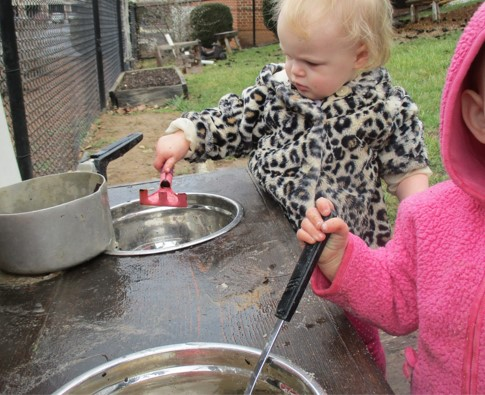 "child ""cooking"" in outdoor kitchen"