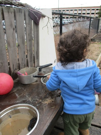 child pretending to cook