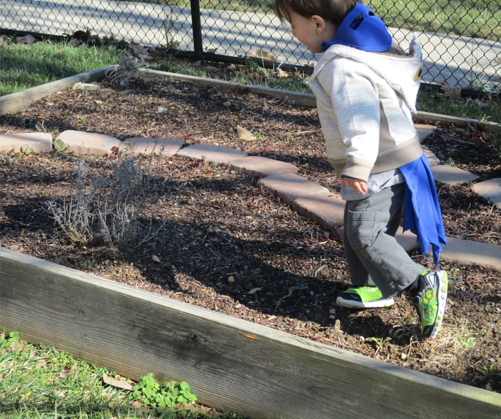 child playing in outdoor classroom
