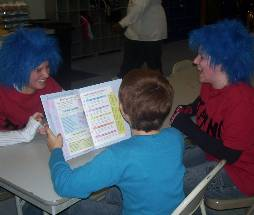child reading to thing 1 and thing 2