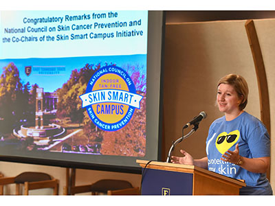 Dr. Katie Baker discusses ETSU's Skin Smart Campus designation during a news conference.