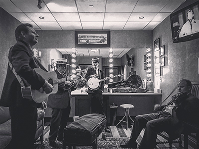 Lincoln Hensley, center, backstage at the Grand Ole Opry with Bobby Osborne and the Rocky Top X-Press (photo contributed by Lincoln Hensley).