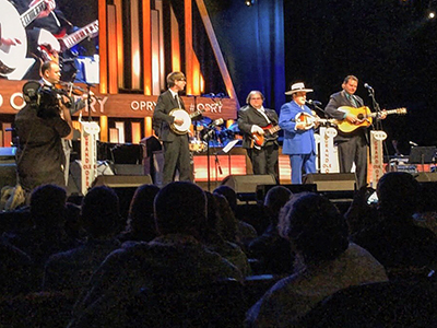 Lincoln Hensley, center, on stage at the Grand Ole Opry with Bobby Osborne and the Rocky Top X-Press