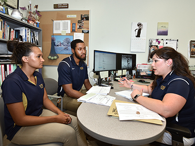 Jessica Mould, right, interacts with fellow Basler Center for Physical Activity employees