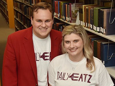 Logan and Alexandria Craft, pictured in the book stacks of ETSU's Sherrod Library