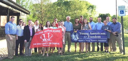 Young Republicans holding their banner with state legislators