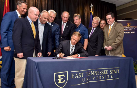 TN Governor Bill Haslam signs FOCUS Bill into law, accompanied by state legislators and ETSU President Brian Noland.