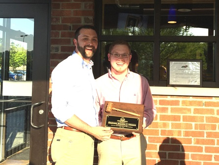 Sean Hoyle presents Chairman Brandon Johnson an award in honor of his service to the ETSU College Republicans.