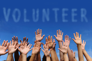 Image of Hands in Air Promoting Volunteering