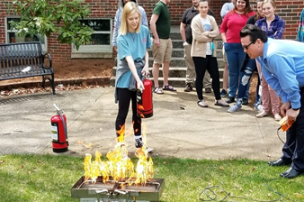 Student putting out a fire